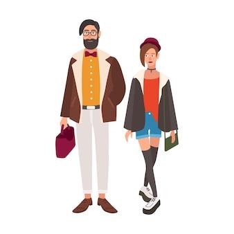Paire de hipsters élégants. jeune homme et femme vêtus de vêtements à la mode fantaisie. couple élégant
