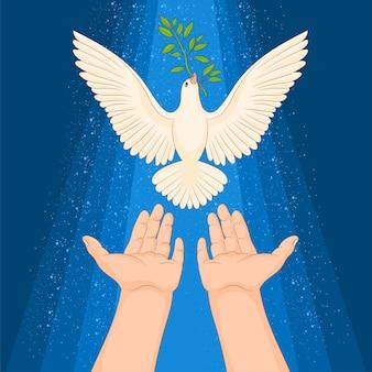 Paire de mains et une colombe volante