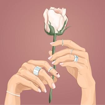 Paire de mains féminines avec anneaux d'argent sur les doigts tenant une rose blanche. illustration à la mode.