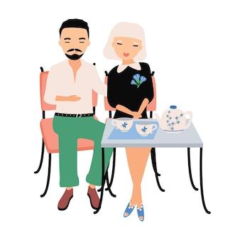 Paire de personnages de dessins animés masculins et féminins vêtus de vêtements élégants assis à table, câlins et buvant du thé. homme et femme à un rendez-vous romantique au café. illustration vectorielle coloré dans un style plat