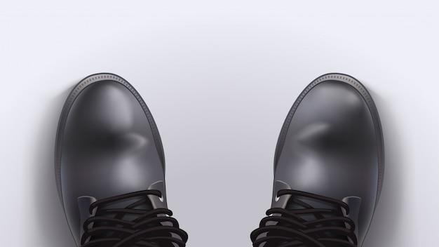 Paire de vieilles bottes avec une ombre