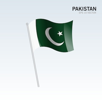 Pakistan agitant le drapeau isolé sur fond gris