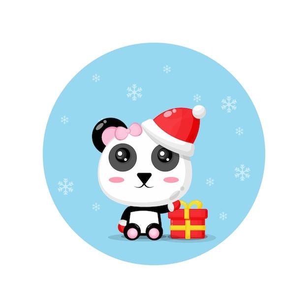 Panda mignon portant un chapeau de père noël