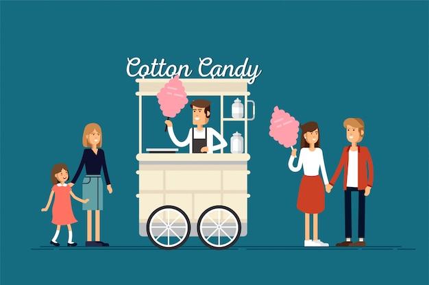 Panier de bonbons de coton de rue détaillé créatif ou boutique avec douceur et avec le vendeur. les jeunes achètent et mangent de la barbe à papa.