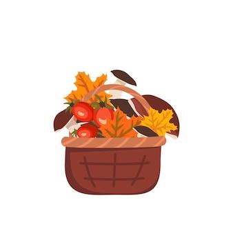 Panier avec champignons feuilles d'érable et églantier récolte d'automne dans la forêt