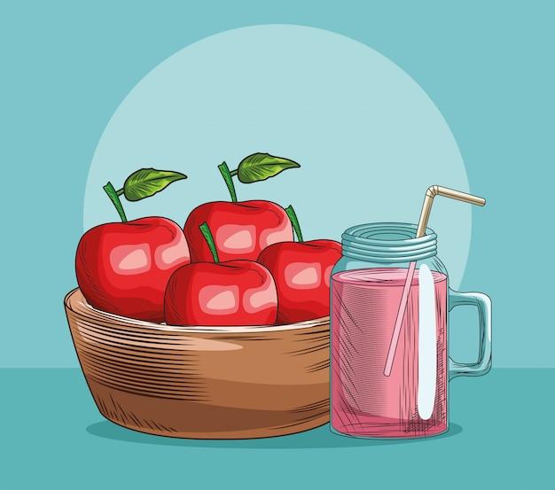 Panier de pommes et jus de fruits frais