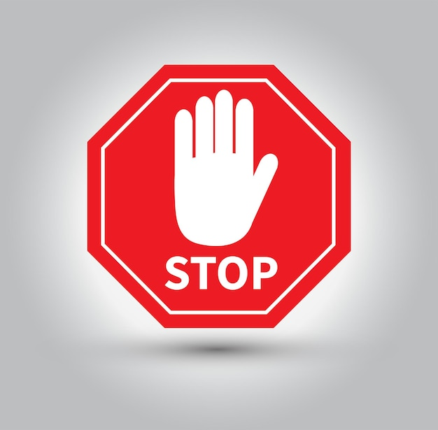 Panneau d'arrêt rouge isolé sur fond gris