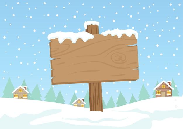 Panneau en bois blanc avec neige blanche sur le village