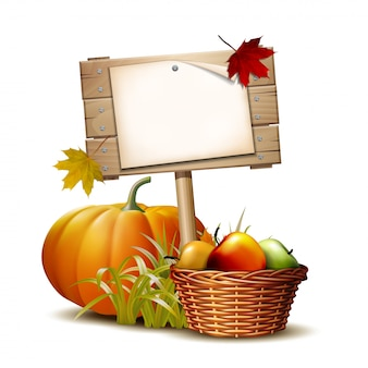 Panneau en bois avec citrouille orange, feuilles d'automne et panier complet de pommes mûres. fête des récoltes d'automne ou jour de thanksgiving. légumes respectueux de l'environnement.