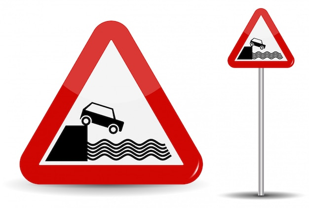Panneau routier avertissement départ pour le remblai. dans le triangle rouge, la côte, l'eau et la voiture sont schématiquement représentés.