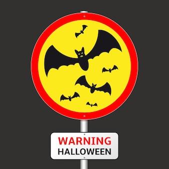 Panneau de signalisation d'halloween d'avertissement avec des silhouettes de chauves-souris