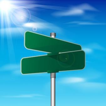 Panneau de signalisation de trafic vert blanc sur fond de ciel