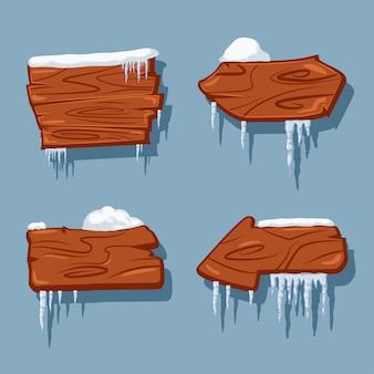 Des panneaux en bois blancs dans la neige et des glaçons dessin animé jeu isolé sur.