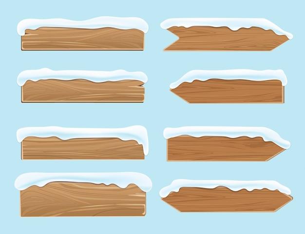 Panneaux de bois planches recouvertes de neige. décoration de vecteur de noël festif isolé