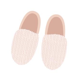 Pantoufles rose clair, vue de dessus. une paire de chaussons douillets avec un élément tricoté. chaussures maison.