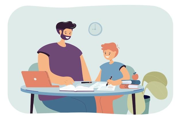 Papa aide son fils à faire ses devoirs