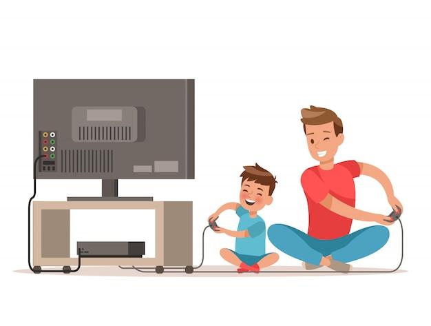 Papa et fils jouant à un jeu