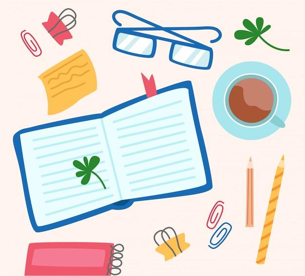 Papeterie à plat pour travail de bureau ou étude, livre, verres, papier à notes, tasse à café, cahier