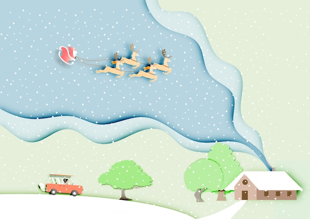 Papier d'art du père noël avec le renne sur la neige