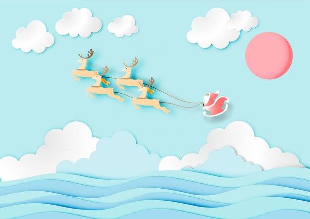 Papier d'art du père noël avec rennes sur ciel bleu et fond de l'océan bleu