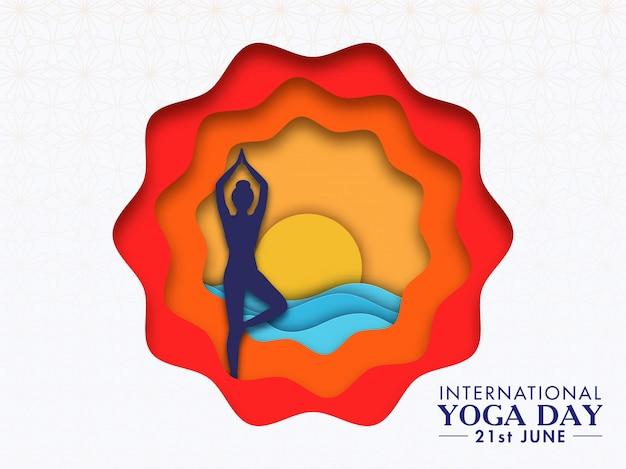 Papier coloré coupé abstrait avec silhouette femme faisant vrikshasana (arbre) pose au coucher ou au lever du soleil pour la journée internationale du yoga.