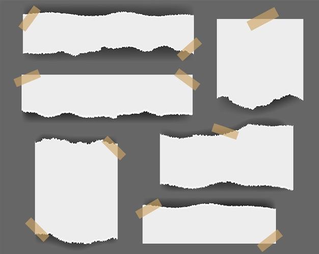 Papier déchiré isolé sur gris