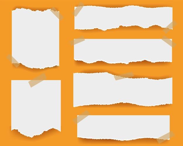 Papier déchiré isolé sur orange
