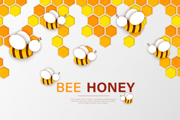 Papier découpé avec abeille et nid d'abeilles.