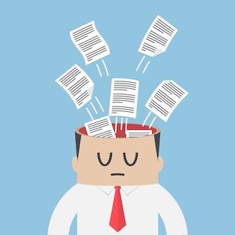 Papier de données s'envolant de la tête d'homme d'affaires