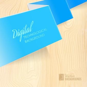 Papier plié sur un bureau en bois