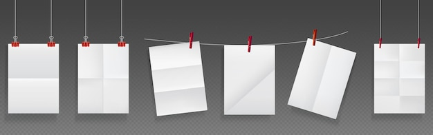 Le papier plié est suspendu à une corde et des épingles, des feuilles vierges de papier blanc de texture froissée.