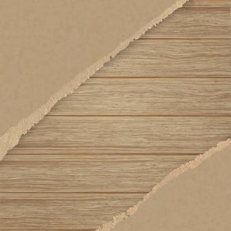 Papier texturé brun déchiré sur un mur de planche de bois.