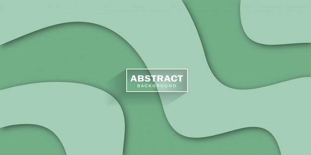 Papier vert coupé avec des formes ondulées élégantes abstraites et relief 3d.