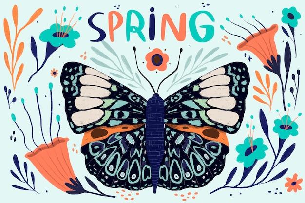 Papillon à ailes ouvertes le printemps arrive