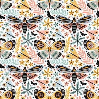 Papillon doodle modèle sans couture avec feuillage fleur ornement