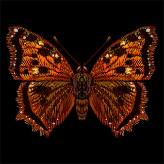 Le papillon de logo vectoriel pour tatouage ou t-shirt ou vêtement