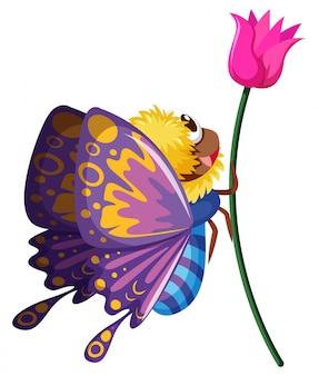 Papillon volant par la fleur rose
