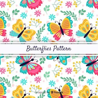 Papillons et feuilles de fond coloré