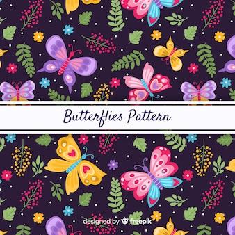 Papillons et feuilles de fond sombre