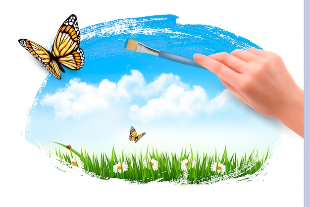 Papillons et main avec pinceau.