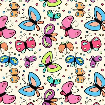 Les papillons et les points dessinés à la main motif
