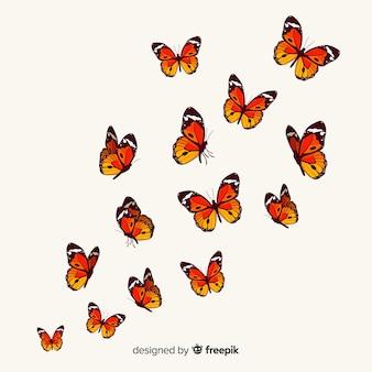 Papillons réalistes volant à fond