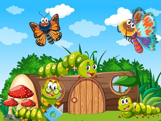 Papillons et vers vivant dans la scène du jardin pendant la journée