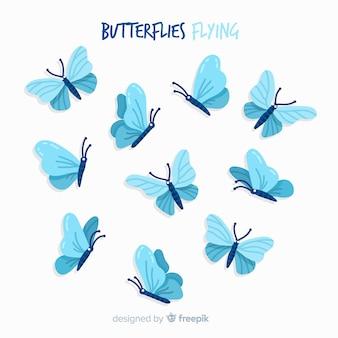 Papillons volant à fond