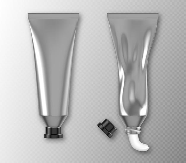 Paquet de tube en argent avec du dentifrice à la crème pour les mains ou de la peinture blanche isolée sur une maquette réaliste de mur transparent de récipient en aluminium blanc avec bouchon noir