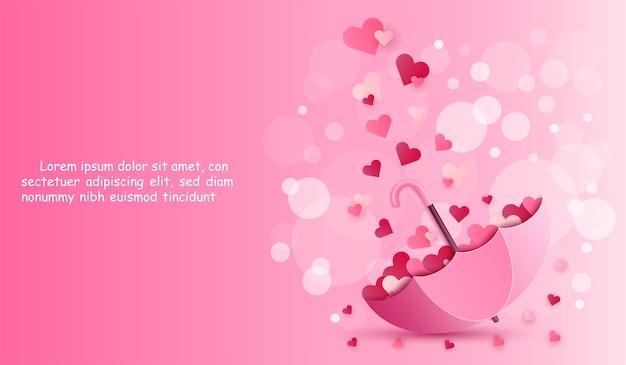 Parapluie et coeur sur fond de couleur rose.