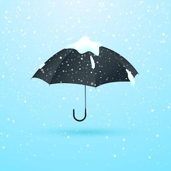 Parapluie dans la neige sous les flocons de neige