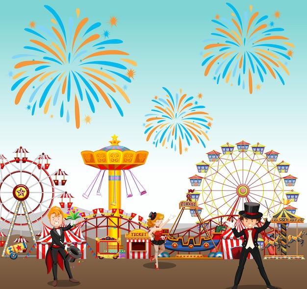 Parc d'attractions avec cirque et grande roue et feux d'artifice