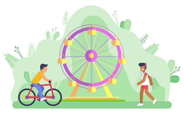Parc d'attractions ferris wheel et cycliste man