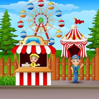 Parc d'attractions avec grande roue, billetterie et tente de cirque